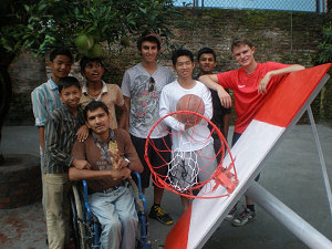 The boys with the three Canadian Volunteers on the completion of the  Basketball court